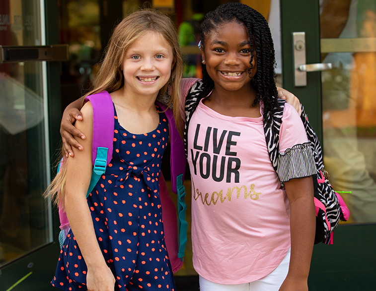 Lower School students smile as they begin their first day of school.