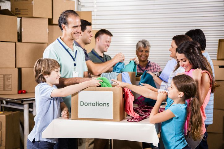 group of people sorting through donations
